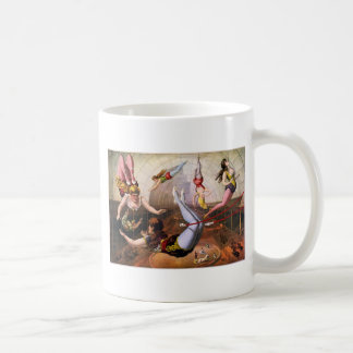 Female trapeze acrobats at circus coffee mug