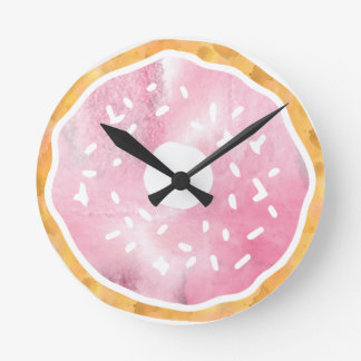Femenino palidezca - el reloj rosado del buñuelo