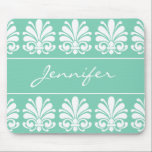 "Feminine Shell Flourish Damask Personalized Mouse Pad<br><div class=""desc"">Looking for a special gift for a friend, family member, or co-worker? This lovely feminine design features a white shell flourish damask motif against an aquamarine background. It is ready to personalize with your name or monogram. If you prefer the item without the monogram, these design elements may be removed....</div>"