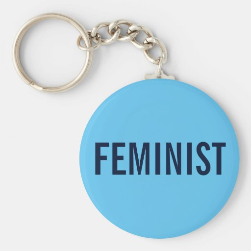 Feminist, bold navy text on sky blue keychain