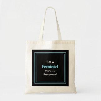Feminist superpower slogan white on black tote bag