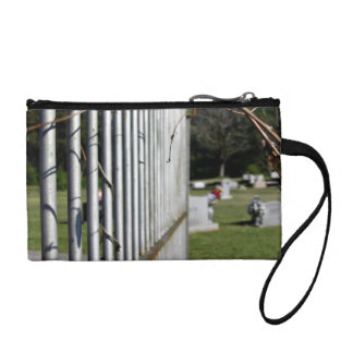 Fence at a cemetery coin purse