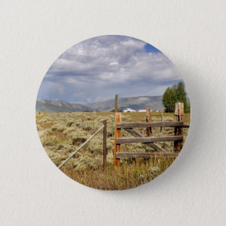 fence by prairie in Colorado Button