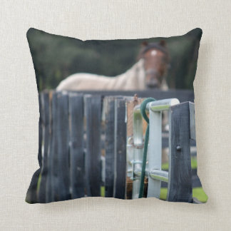 fence with faded horse behind throw pillow