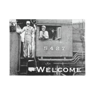Ferrocarril del vintage del ingeniero locomotor y felpudo