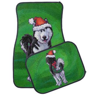 Festive Husky in Santa Hat on Green Car Mat