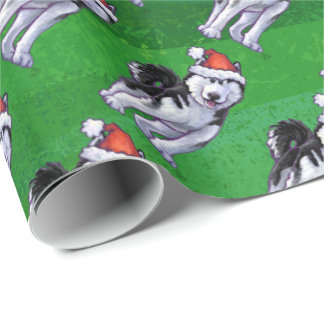 Festive Husky in Santa Hat on Green Wrapping Paper