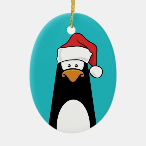 Festive Penguin in a Santa Hat (blue) Double-Sided Oval Ceramic Christmas Ornament