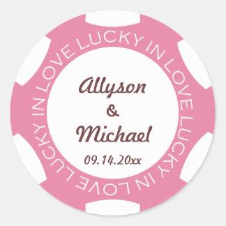 Ficha de póker afortunada en rosa de la etiqueta