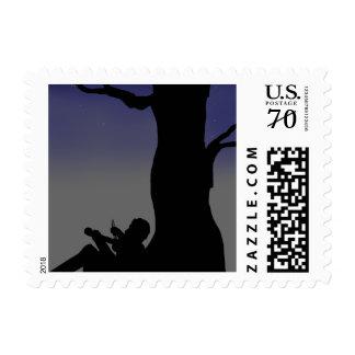 Fiddler Sitting Against Tree Postage