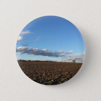 Field in spring button
