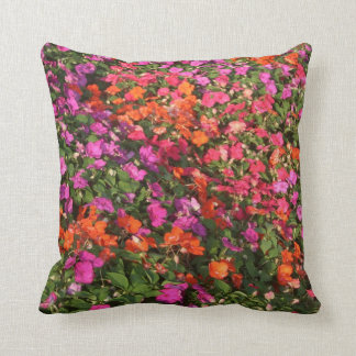 Field of purple pink orange impatients flowers throw pillow