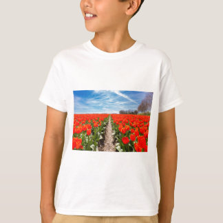 Field of red tulips flowers with blue sky T-Shirt