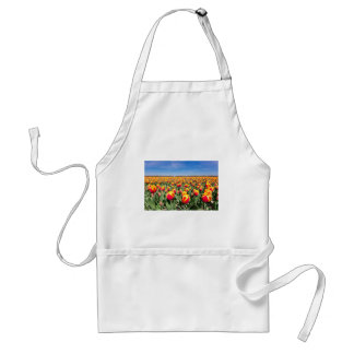 Field of red yellow tulips with blue sky adult apron