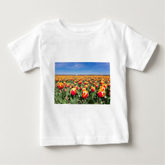 Field of red yellow tulips with blue sky baby T-Shirt