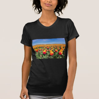 Field of red yellow tulips with blue sky T-Shirt