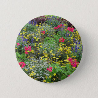 Field of spring flowers in bloom button