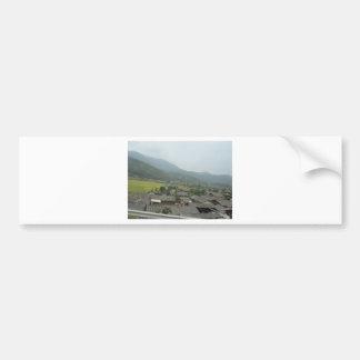 field sky grassland houses bumper sticker