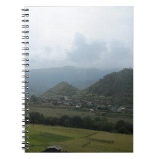 field sky grassland houses mountain spiral notebook