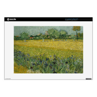 """Field with flowers near Arles by Vincent Van Gogh 15"""" Laptop Skin"""