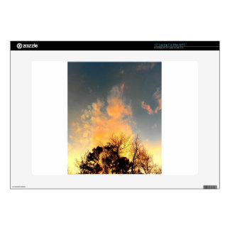 """Fiery Sunset over the tree tops 15"""" Laptop Skin"""