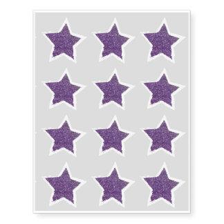 Fiesta como un tatuaje púrpura de la estrella del tatuajes temporales