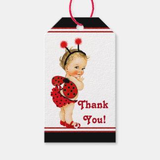 Fiesta de bienvenida al bebé rubia del chica de la etiquetas para regalos