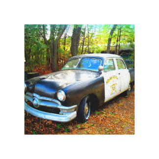 Fifties Highway Patrol Car in Junk Yard Weeds Canvas Print