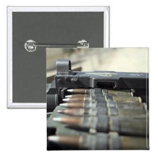 Fifty-caliber machine gun rounds button