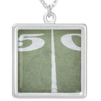 Fifty yard line on sports field pendant