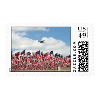 fighter jet over flags stamp
