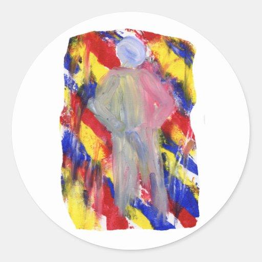 Figura blanca delante de manchas amarillas rojas pegatina redonda