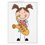 Figura chica del palillo con el saxofón felicitación