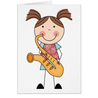Figura chica del palillo con el saxofón tarjeta de felicitación