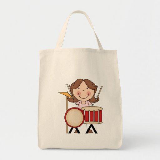 Figura chica del palillo con los tambores bolsas de mano