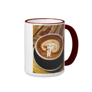 Figura de Cappacino del hombre con la taza de café