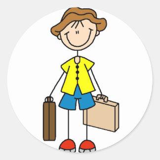Figura del palillo con el pegatina del equipaje