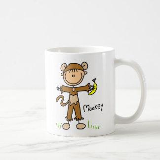Figura del palillo en taza del juego de mono