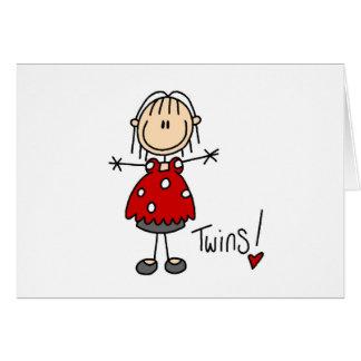 Figura del palillo que cuenta con a gemelos tarjetas