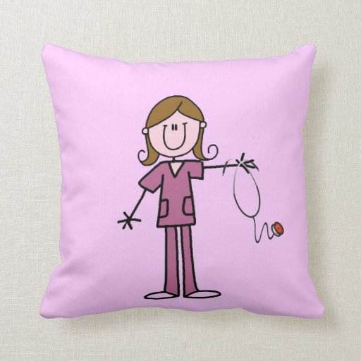 Figura femenina enfermera del palillo del pelo de  almohada