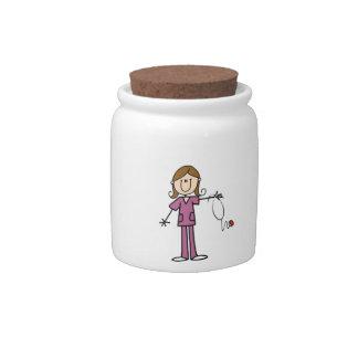 Figura femenina enfermera del palillo del pelo de  jarras para caramelos