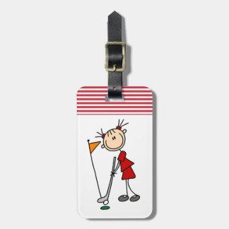 Figura femenina golfista del palillo etiqueta para maleta