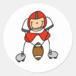 Figura rojo del palillo del fútbol pegatina redonda