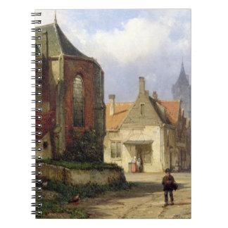 Figure antes de una iglesia de ladrillo en una ciu cuadernos