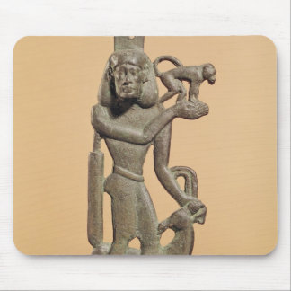 Figure of a man holding a monkey mouse pad