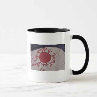 Figures and animals around a sun mug