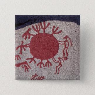 Figures and animals around a sun pinback button