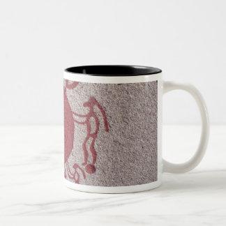 Figures and animals around a sun Two-Tone coffee mug