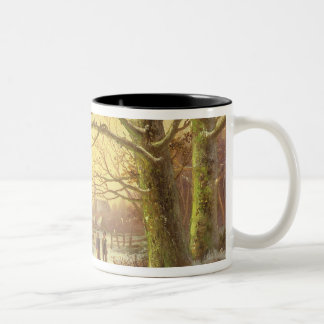 Figures on a path before a village in winter Two-Tone coffee mug