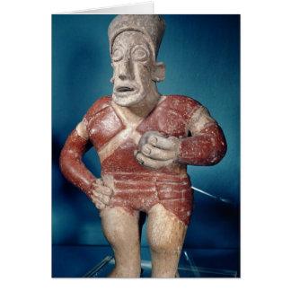 Figurine of a tlachtli player wearing a helmet card